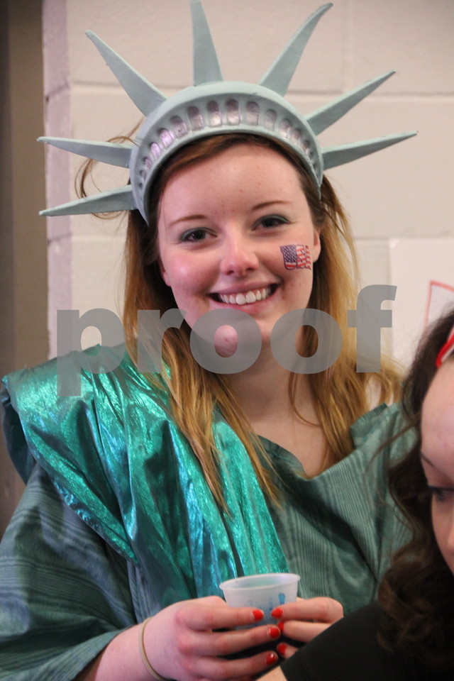The Festival of Nations was held at the Iowa Central Community College campus in the Career Education building in Fort Dodge. The event took place on Sunday, April 3, 2016. Pictured is: Melanie Lambert,  dressed as the Statue of Liberty, who had a booth at the event, for the college  Student  Government. Almost every nation was represented with booths, food, dancing, or demonstrations of various skills. Present were also a few who were dressed in national costumes as well.