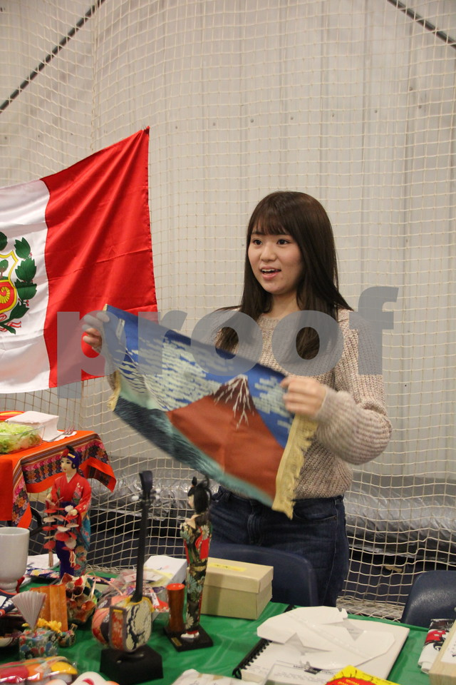 The Festival of Nations was held at the Iowa Central Community College campus in the Career Education building in Fort Dodge. The event took place on Sunday, April 3, 2016. Pictured is: Chiaki Masuda, who had a booth at the event. Almost every nation was represented with booths, food, dancing, or demonstrations of various skills. Present were also a few who were dressed in national costumes as well.