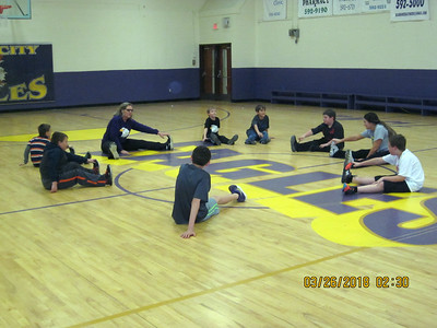 Students in the Tracy City Elementary run club warm up with stretches