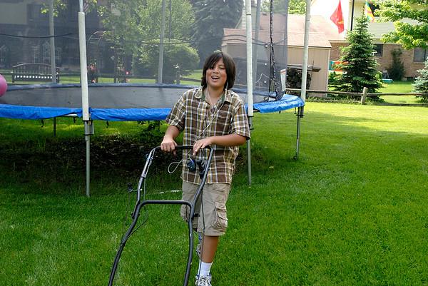 5/31/07 Jonas mowing the lawn