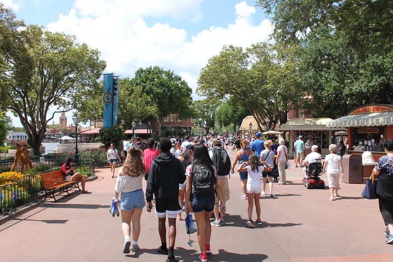 crowds wander at Epcot at Disney World