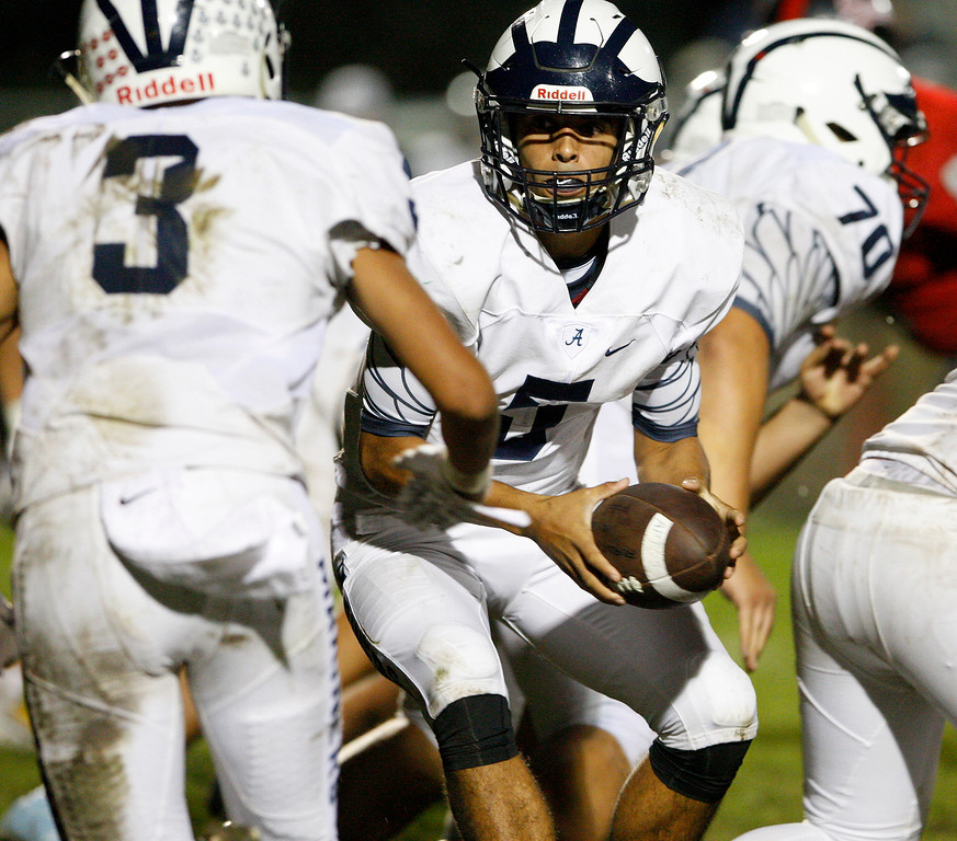 . Aptos quarterback Hunter Matys (5) hands off to running back Bubba Gallardo (3) in the second half of their game against Seaside on Friday, Sept. 29, 2017.  (Vern Fisher - Monterey Herald)