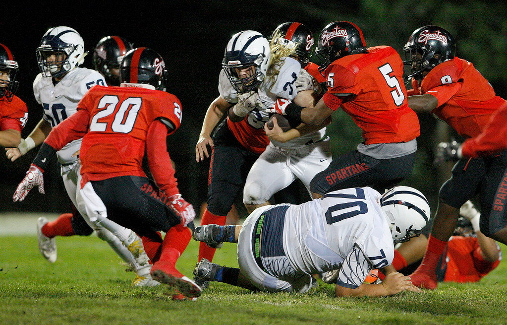 . Aptos running back Titan Garland (34) rushes for yards in the first half of their game against Seaside on Friday, Sept. 29, 2017.  (Vern Fisher - Monterey Herald)