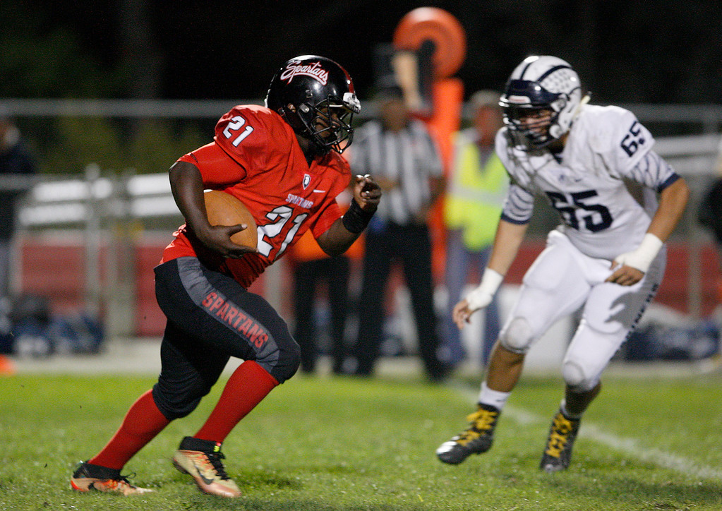 . Seaside\'s Robert Simonton (21) rushes for yards in the first half of their game against Aptos in Seaside on Friday, Sept. 29, 2017.  (Vern Fisher - Monterey Herald)