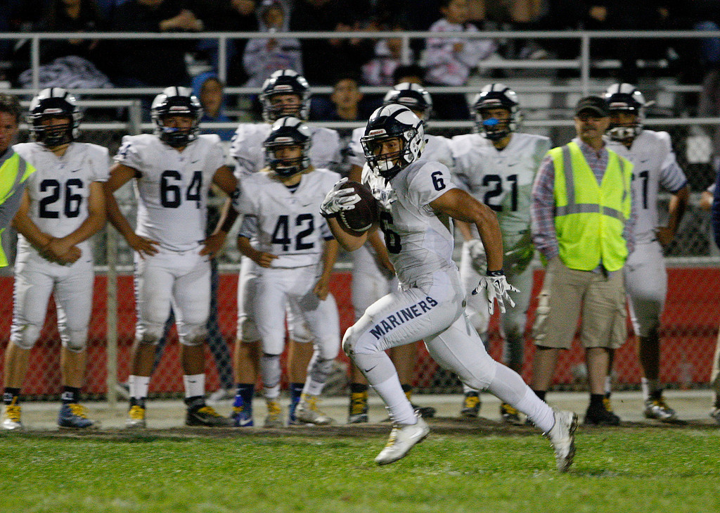 . Aptos running back Marcos Reyes (6) rushes for yards in the first half of their game against Seaside on Friday, Sept. 29, 2017.  (Vern Fisher - Monterey Herald)