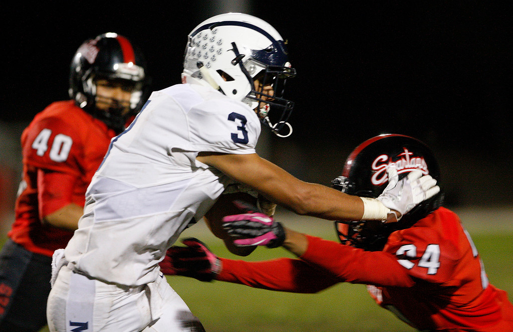 . Aptos running back Bubba Gallardo (3) goes up against Seaside\'s Michael Garnett (24) in the second half of their game against Seaside on Friday, Sept. 29, 2017.  (Vern Fisher - Monterey Herald)