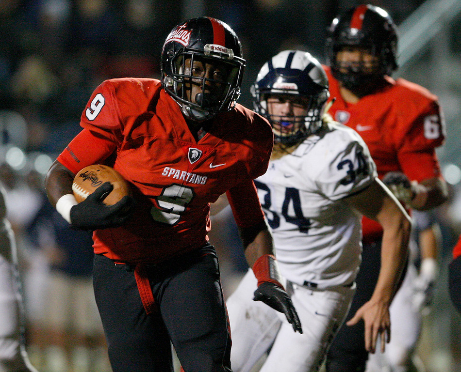 . Seaside\'s Demarcus Hawkins (9) rushes for yards in the first half of their game against Aptos in Seaside on Friday, Sept. 29, 2017.  (Vern Fisher - Monterey Herald)