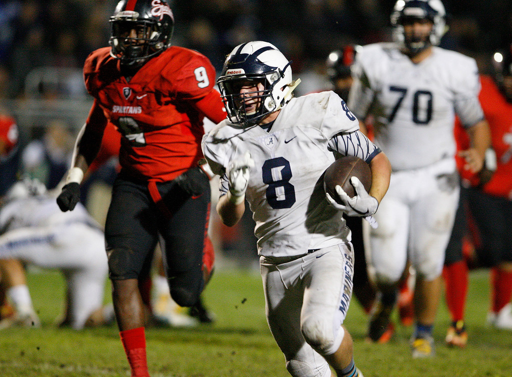 . Aptos running back Josh Powell (8) rushes for yards in the first half of their game against Seaside on Friday, Sept. 29, 2017.  (Vern Fisher - Monterey Herald)