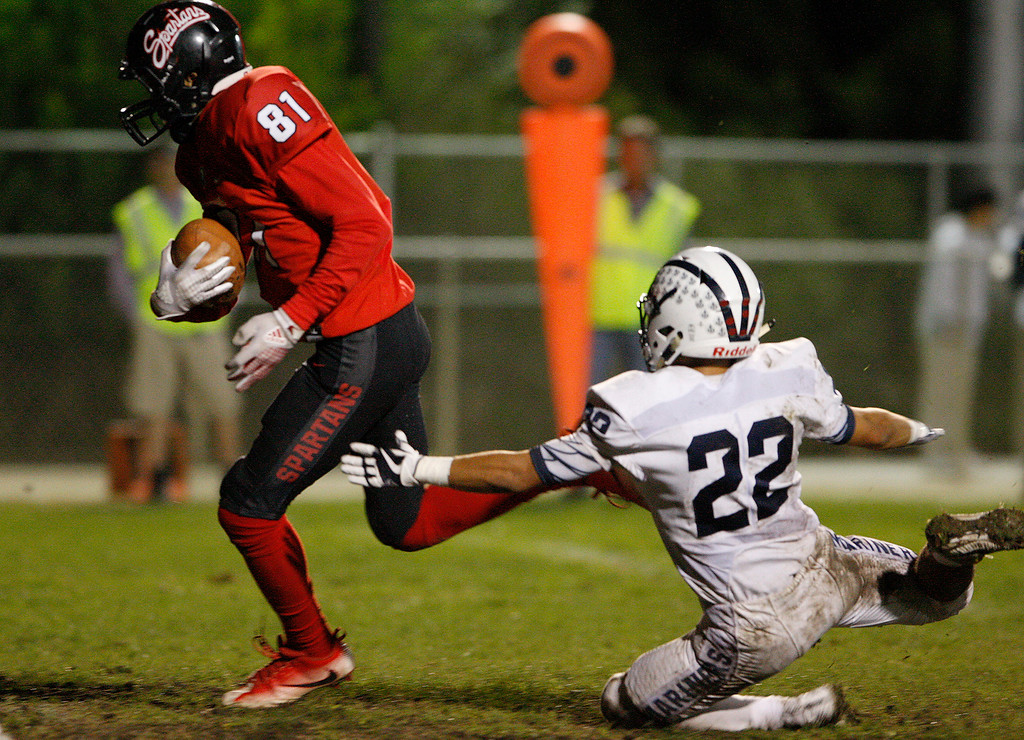 . Seaside\'s Harold English (81) with a long pass reception past Aptos\' Desmond Mendoza (22) in the second half of their game against Aptos in Seaside on Friday, Sept. 29, 2017.  (Vern Fisher - Monterey Herald)