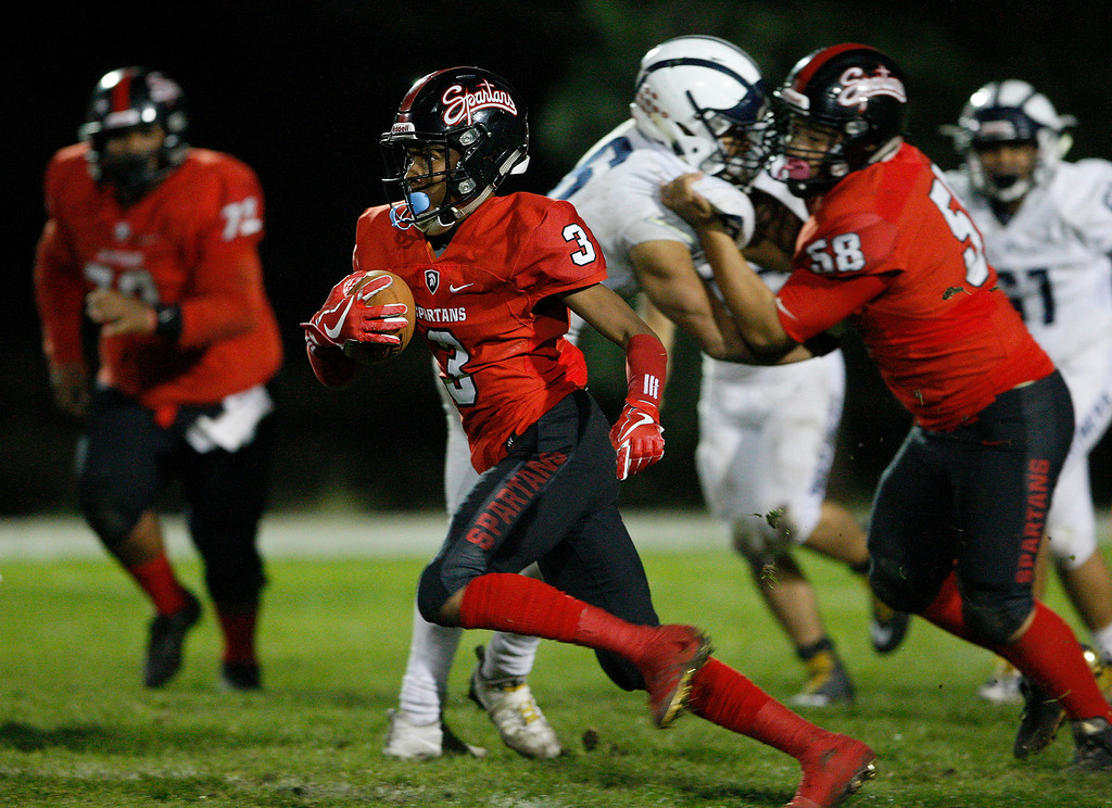 . Seaside\'s De\'Antae Williams (3) rushes for yards in the first half of their game against Aptos in Seaside on Friday, Sept. 29, 2017.  (Vern Fisher - Monterey Herald)