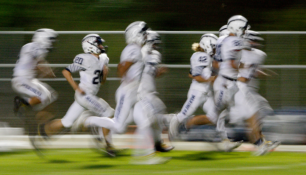 . Aptos takes the field for the second half of their game against Seaside on Friday, Sept. 29, 2017.  (Vern Fisher - Monterey Herald)