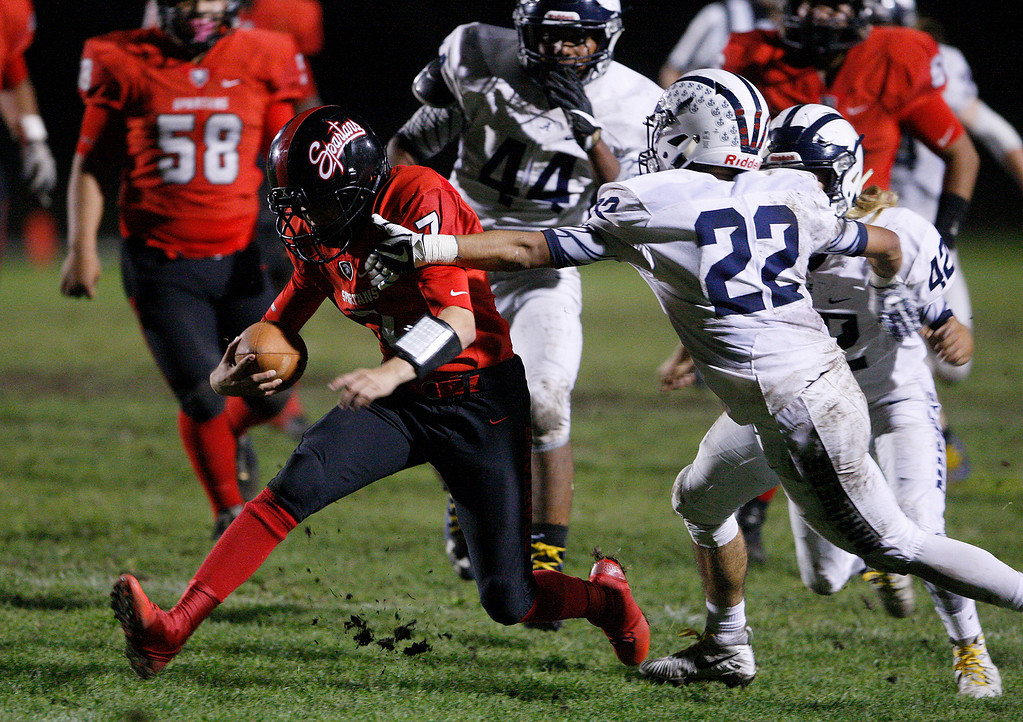 . Seaside\'s Ivan Ochoa (7) scrambles past Aptos\' Desmond Mendoza (22) in the first half of their game against Aptos in Seaside on Friday, Sept. 29, 2017.  (Vern Fisher - Monterey Herald)