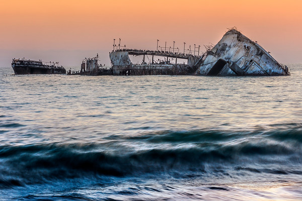 Cement ship at sunset all alone