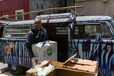 "Todd ""Gready"" Cornish unloads donated produce  at the Carlton Street Stable in Baltimore, Md. on May 12, 2020."