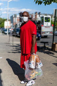 Eric Richardson, 52, poses for a portrait outside the Harvey Jones Towers in the Sandtown neighborhood of Baltimore, Md. on May 12, 2020.