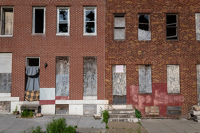 Boarded up homes in West Baltimore. Gready mentions how sad it is that all these homes are just abandoned.