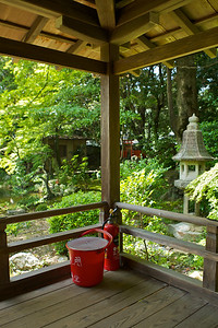 Backstage at Daikaku-ji temple in Summer  Nice Garden with Fire Extinguish Equipment on Veranda