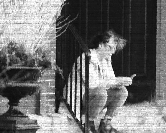 Checking her phone on the stoop, urban street art