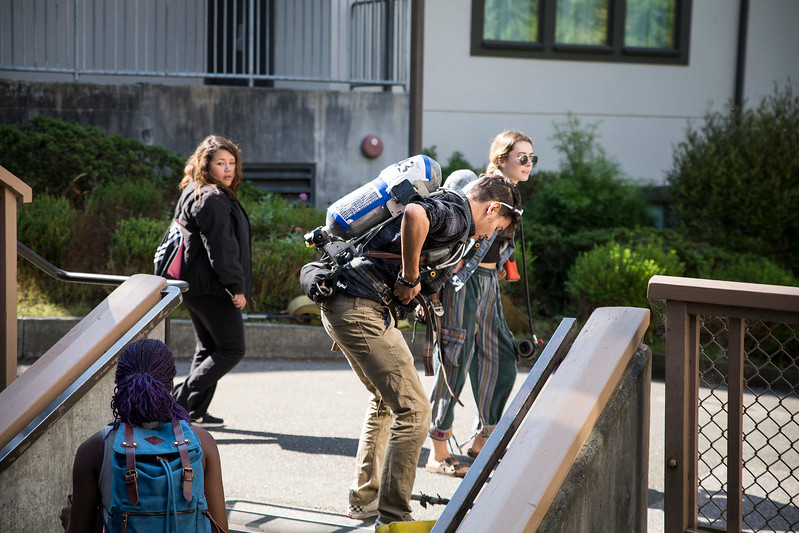 Some Humboldt State students tried on the gear to walk in honor as well. Austin Priato, a forestry major,  makes it up his first set of stairs. He said he planned to go with the firefighters as long as he could.  (Sam Armanino - Times-Standard)