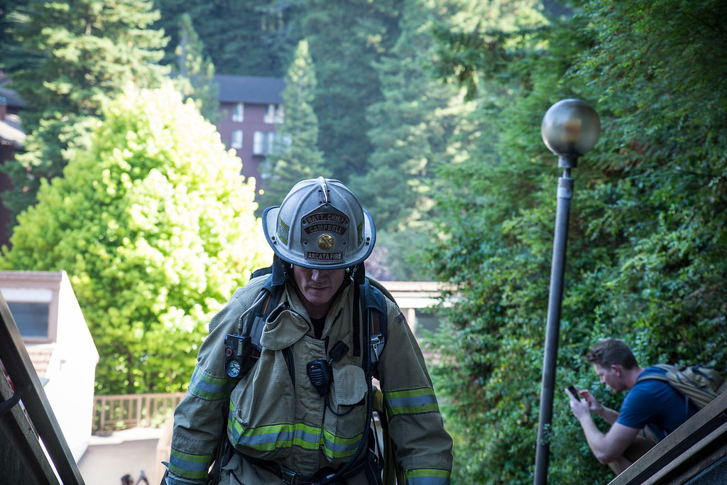 . Battalion chief Sean Campbell makes it up to the top of the student dorms only to turn around a head back down. He carried a full pack, hose and equipment which is what he said the firefighters responding to the Sept. 11 attacks would have been wearing. He said his community drives him to climb. (Sam Armanino - Times-Standard)