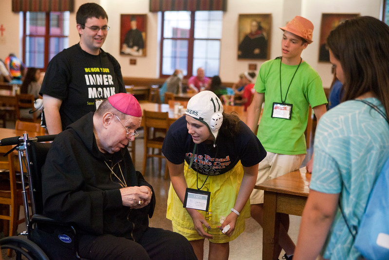 "Archbishop Daniel Buechlein talked with youth during an ice cream social at the ""One Bread, One Cup"" Youth Liturgical Leadership Conference on July 9, 2013."