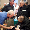 Archbishop Daniel Buechlein talks with alumni during a reception at the Alumni Reunion on July 28, 2014.
