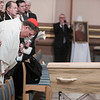 Cardinal Joseph Tobin bows before the casket of Archbishop Emeritus Daniel Buechlein, OSB, during the funeral Mass at the Cathedral of Saints Peter and Paul in Indianapolis on January 31, 2018.
