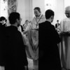 Archabbot Timothy Sweeney and Archbishop Jadot distribute communion during Mass.