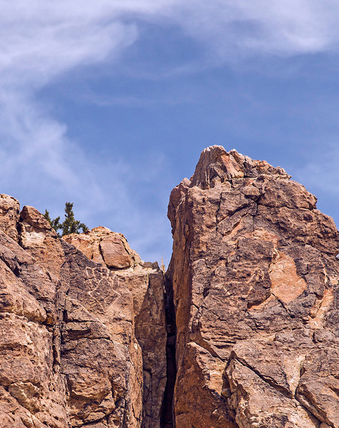 Petroglyphs can be seen near the top of the rock, on either side of the cleft.