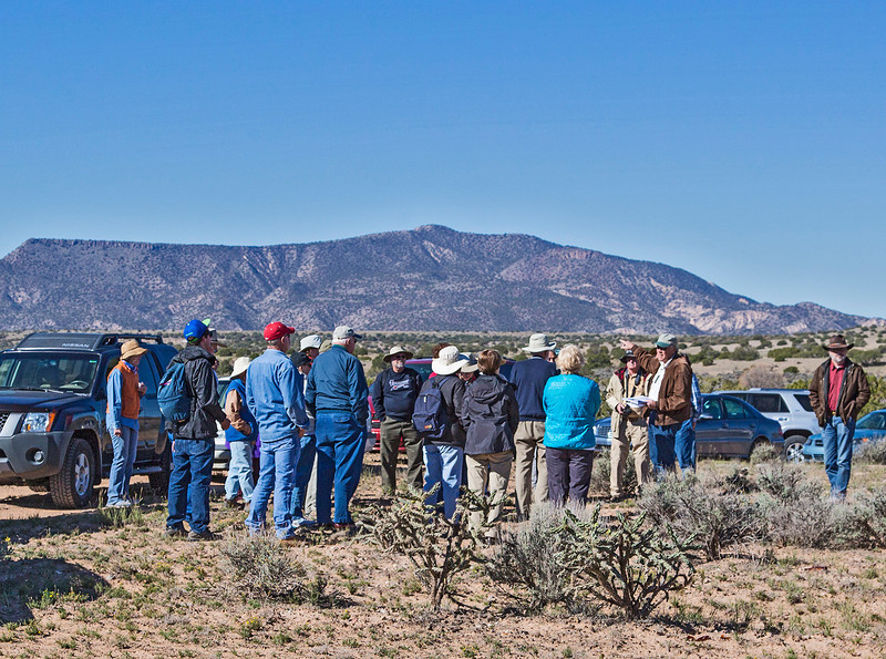 Our first stop is at the location of numerous garden plots, a mile or so from the site of the pueblo. Our leader, Dr. Tim Maxwell (on the right in the brown jacket), give us our first briefing.