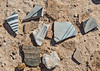 Pottery sherds (of which there are many) plus a couple of rocks.