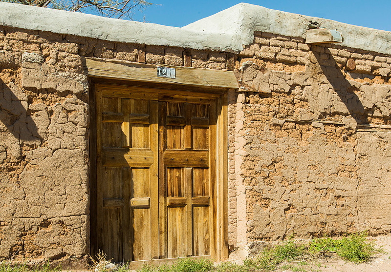 A nice old adobe wall with weathered doors.