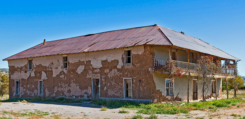 """With the site tour completed we drive a relatively short distance to the village of el Rito.This once-elegant """"adobe hacienda"""" is on the outskirts of the village.  Needs a little work, no?"""