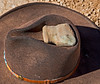 One sharp-eyed group member discovered this stone axe head. Note that all such found objects are returned to the where they were found. The hat looks old, but is not ancient.