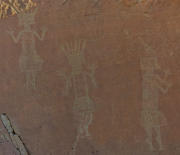"Pertoglyphs of three female Yei figures. I have no idea what the figure above the center and right Yei might represent. Note that while these petroglyphs have been vandalized, through the ""magic of Photoshop"" they have been restored."