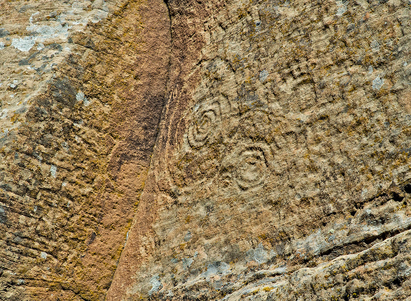 Spiral petroglyph.To the right of the spiral there appears to be a representation of either a hand or a bear footprint.