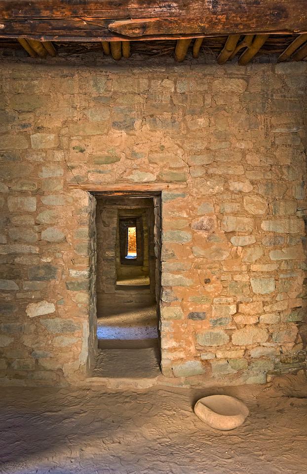 A long passageway through multiple rooms.