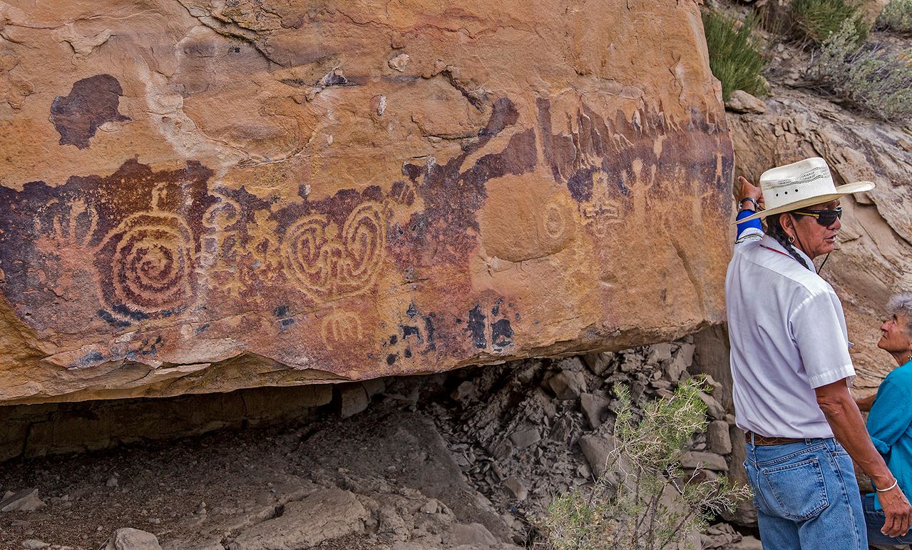 Our Ute guide, Rickey Hayes, explains that these ancient petroglyphs tell the Hopi story of the creation of our world by Spider Grandmother, and of the people emerging into it through the sipapu (the circular pit seen in kiva floors).