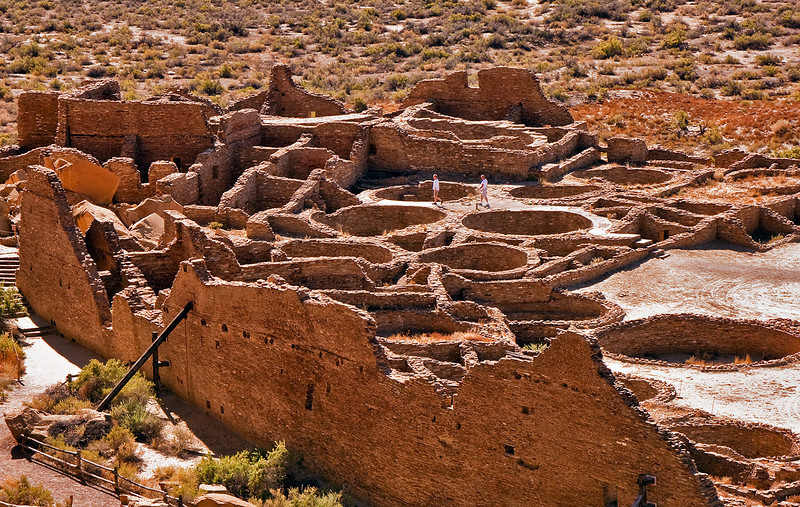 Pueblo Bonito. Note the large rock fall on the left, and the number of kivas (the round structures in the ground).