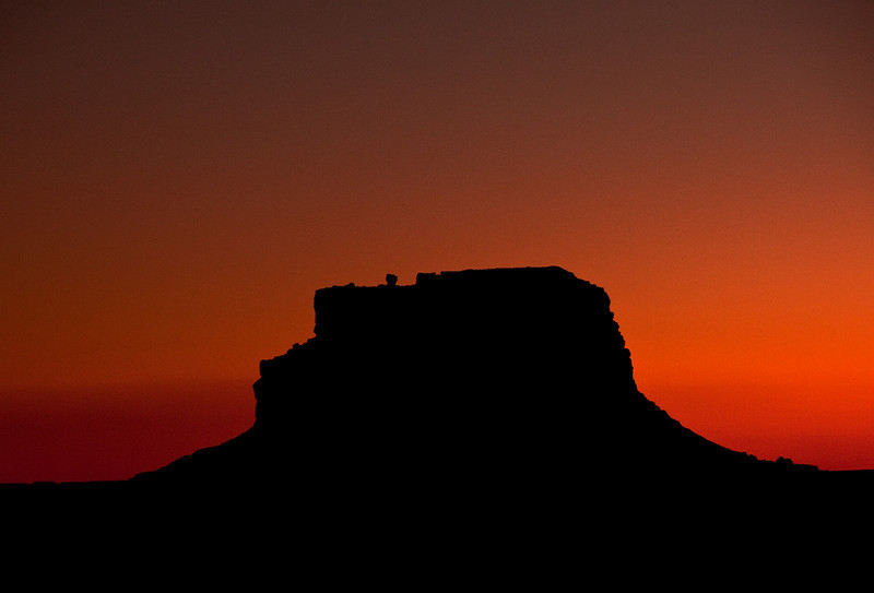 "Sunset with the silhouette of Fajada Butte, where the first non-pueblo observation of the famous ""sun dagger"" petroglyph was made by Anna Sofaer."