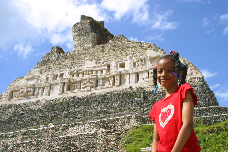 Girl standing in front of El Castillo at Xunantunich, Cayo, Belize.