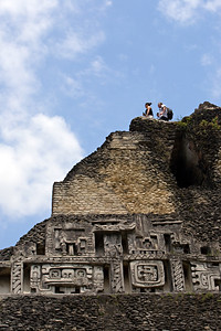 Tourists taking in the view on top of El Castillo (Maiden of the Rock), the tallest structure at the archaeological site Xunantunich in the Cayo District, Belize.