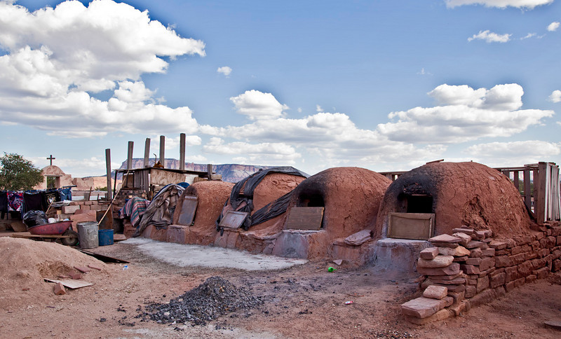 """""""Hornos,"""" wood-fired ovens used for baking. The Mission and Corn Mesa are seen in the background."""