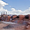 """Hornos,"" wood-fired ovens used for baking. The Mission and Corn Mesa are seen in the background."