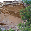 A telephoto shot from the trail below shows a ceiling protecting some relatively new pictographs (painted, not chipped).