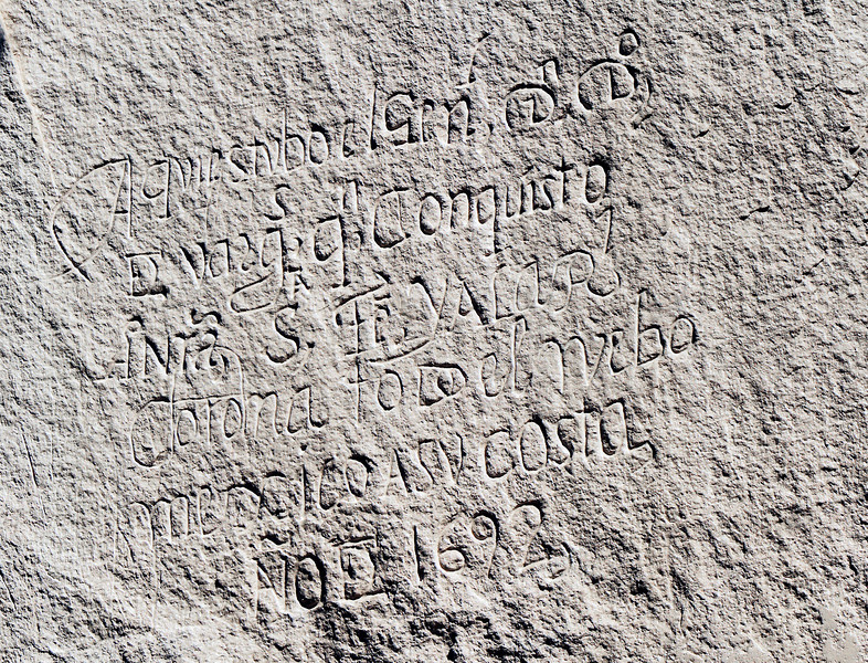 "An ancient Spanish inscription. Not having the guide book, I'll venture a guess at some of it: <br /> <br /> ""Here was General De Vargas,Conqueror;""  then something about Santa Fe, valor and crown, and the year 1692.<br /> <br /> To see additional el Morro inscriptions (from another visit), go to my photo gallery starting at :<br /> <br /> <a href=""http://querencia.smugmug.com/Archaeology/Canyon-de-Chelly/12546773_9uSHg#971180245_n4gDj"">http://querencia.smugmug.com/Archaeology/Canyon-de-Chelly/12546773_9uSHg#971180245_n4gDj</a>"