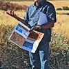 "Zuni Cultural Director Tom Kennedy explaining the layout of Hawikku site.<br /> <br /> The following was copied from: <a href=""http://www.ashiwi-museum.org/hawikku.html"">http://www.ashiwi-museum.org/hawikku.html</a><br /> <br /> ""A Hawikku exhibit installed at the A:shiwi A:wan Museum and Heritage Center (in Zuni) is comprised of 221 representative Hawikku pieces selected by Zunis from the Hawikku collection at the Smithsonian Institute.  Hawikku is one of the Zuni's most important ancestral villages because it was at Hawikku that A:shiwi (Zuni) first made contact with Europeans.  The exhibit describes Hawikku as it was before the Spanish invasion, during the period of Spanish influence, the Pueblo revolt, change during the 1700s through 1800s, arrival of anthropologists and ethnographers, and the controversial excavation of Hawikku."""