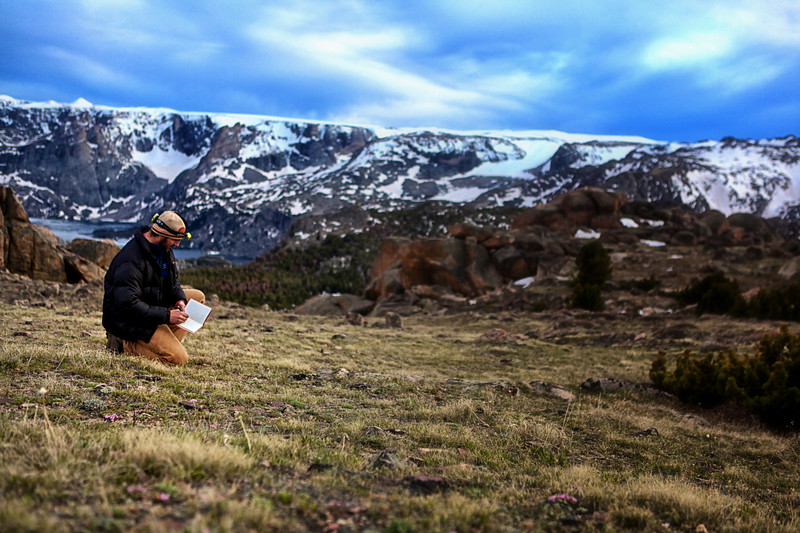 8. Bryon Schroeder records a 5,000 year old campsite high in the northern Wind River Range, Wyoming. Occasionally the days are so long that we have found ourselves excavating or mapping a site late into the night via headlamps.