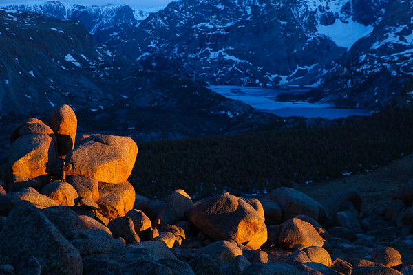 4. Bryon Schroeder catches the final rays of sun as he investigates an outcrop of boulders for prehistoric structures. Wind River Range, Wyoming.