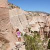 Girl enjoying beautiful view on hiking trip in the mountains. Kasha-Katuwe Tent Rocks National Monument, Close to  Santa Fe, New Mexico, USA